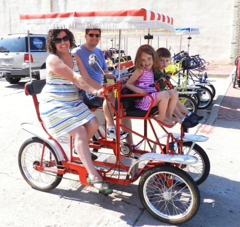 Exploring Historic Downtown Siloam Springs on a surrey with the fringe on top!